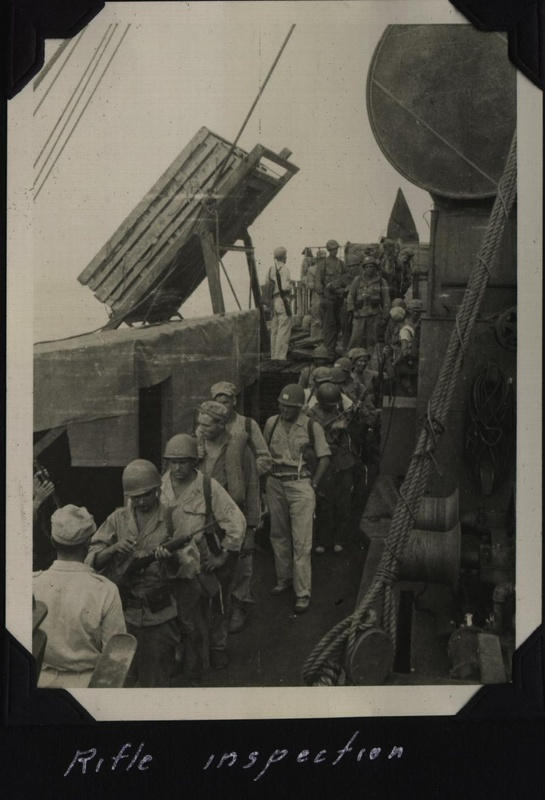 WWII Voyage to Manila rifle inspection